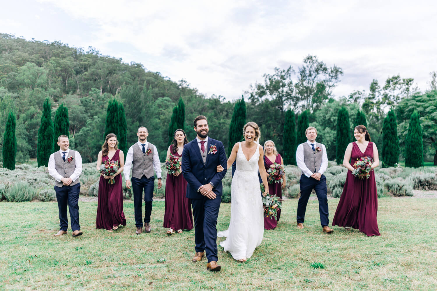 hunter valley wedding photographer bridal party in gardens laughing