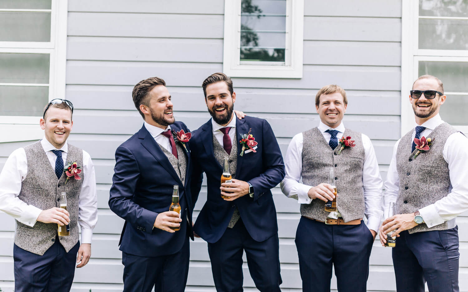 hunter valley wedding photographer groomsmen cheers with beer