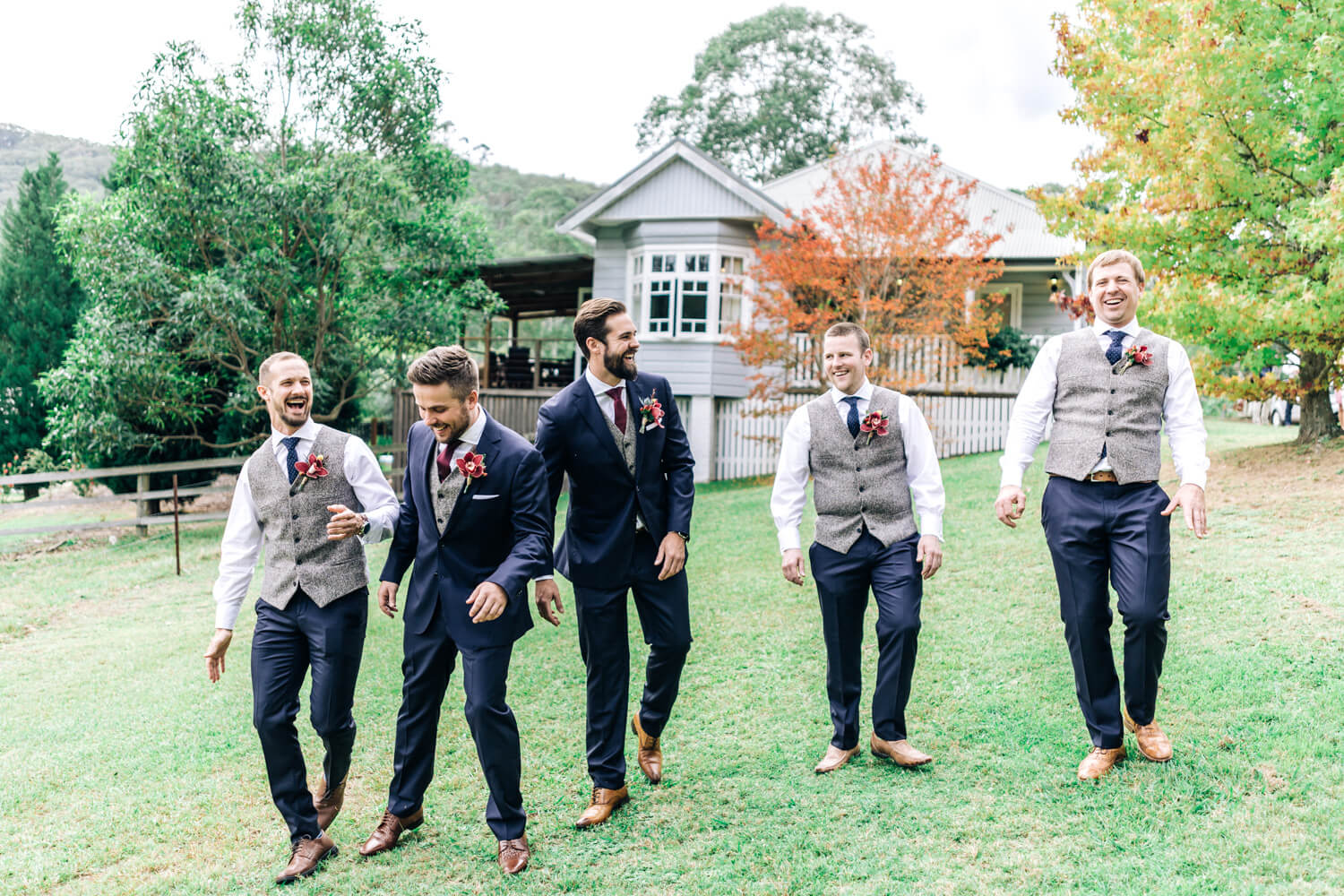 hunter valley wedding photographer walking groom and groomsman walking with autumn colours