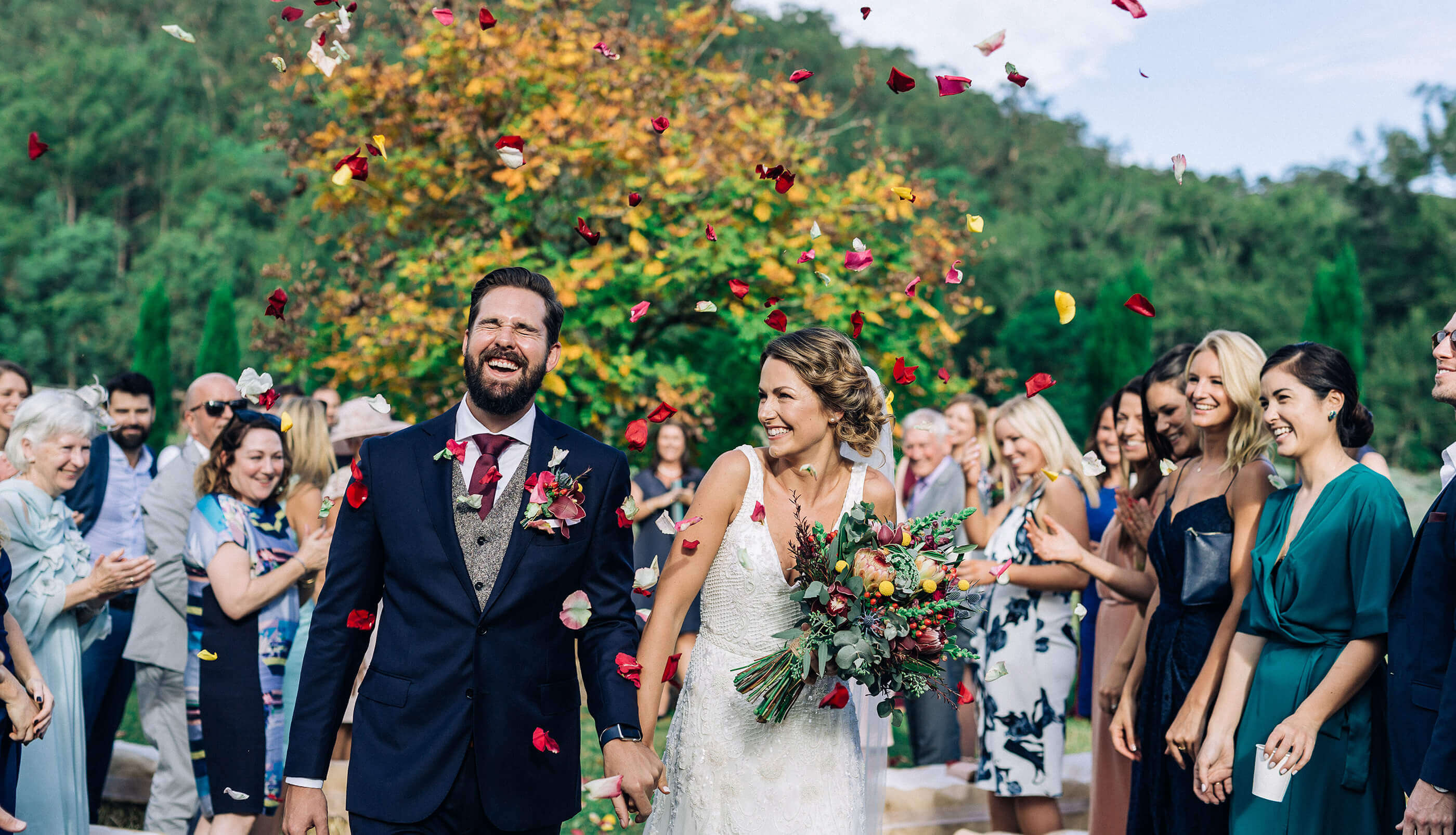 Hunter Valley wedding photographer bride and groom walk down the aisle
