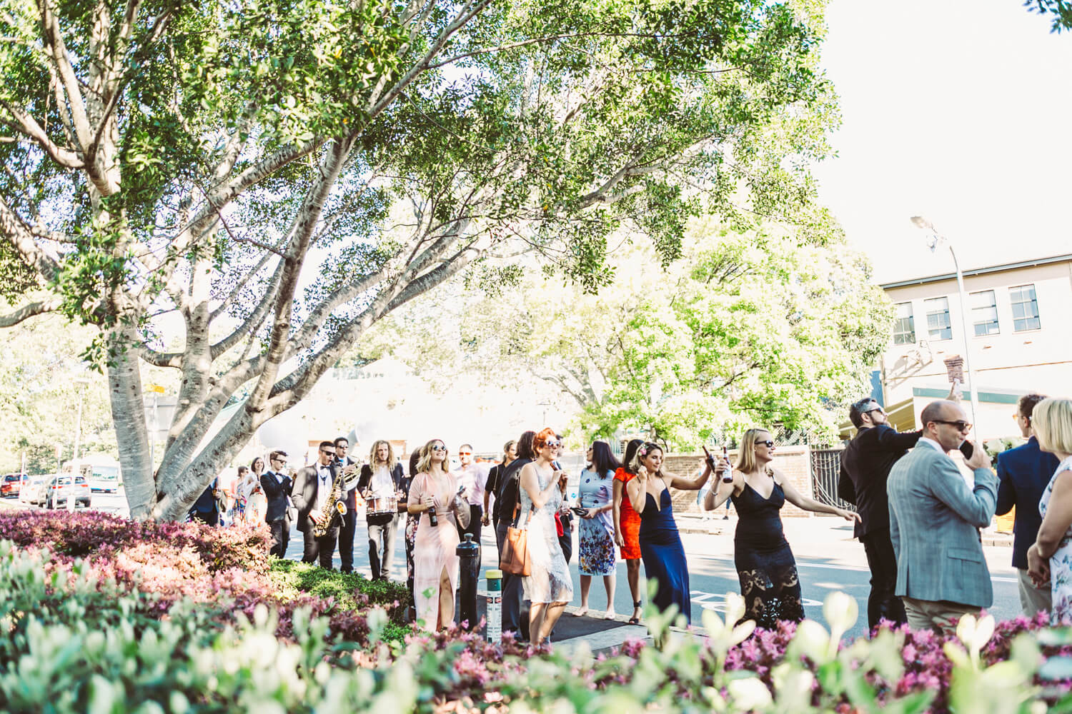 wedding guests have a street part in the rocks