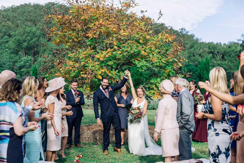 hunter valley wedding photographer bride and groom cheer having just got married