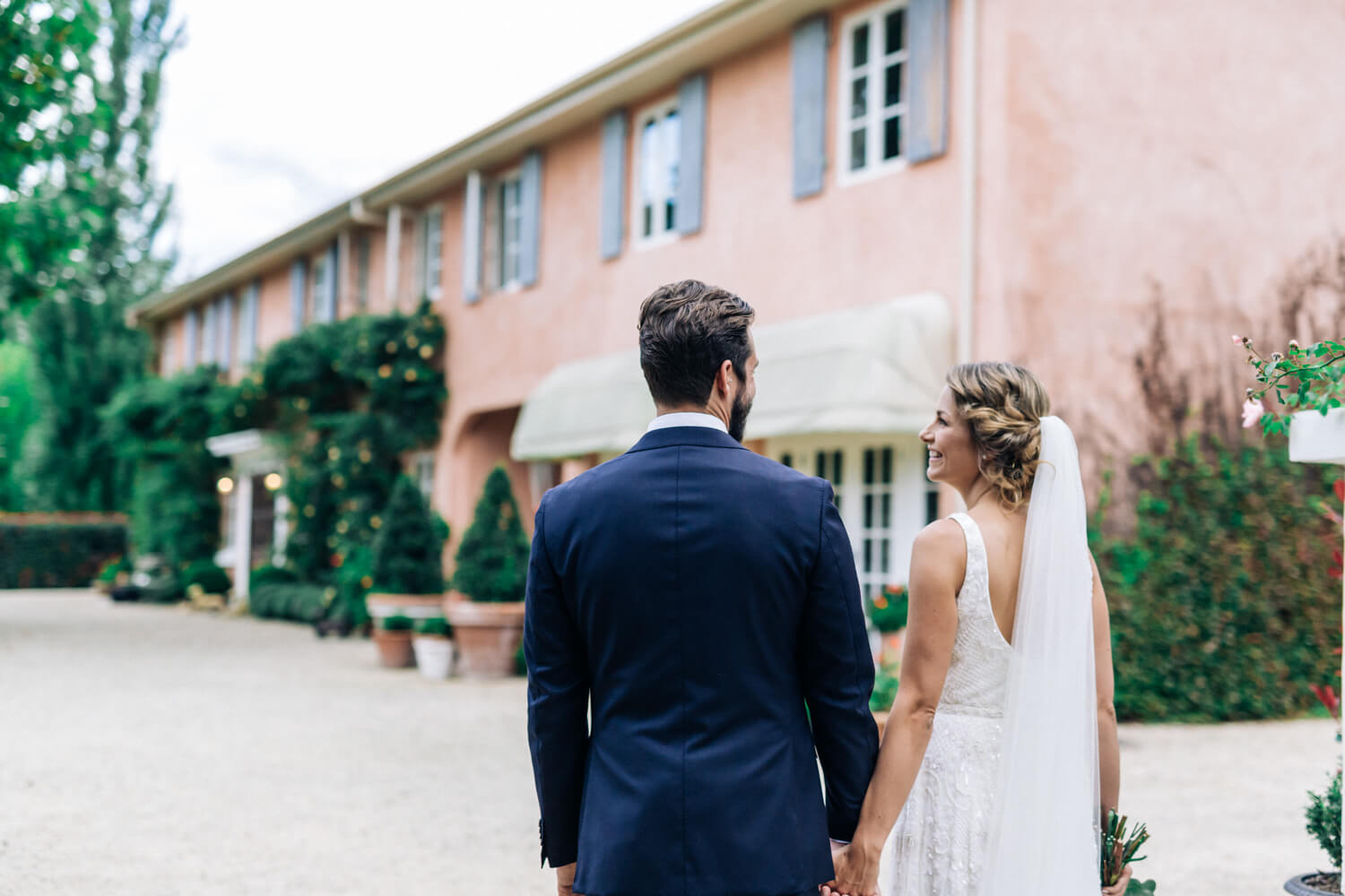 hunter valley wedding photographer bride and groom stand outside Redleaf Wollombi