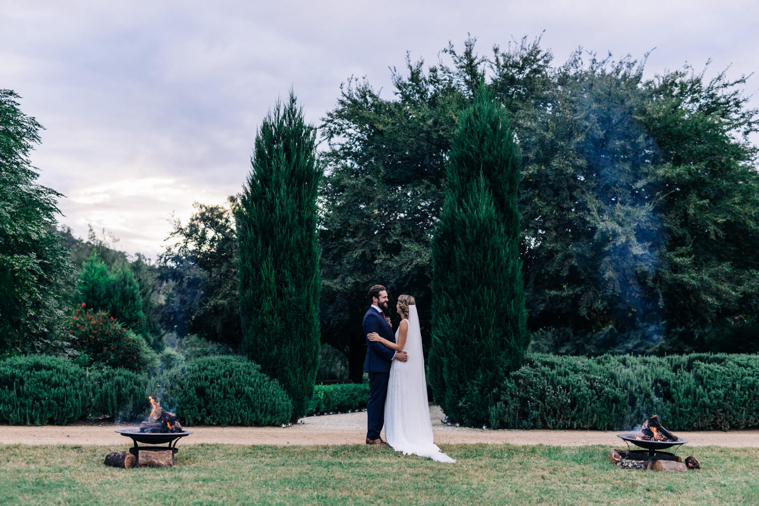 hunter valley wedding photographer bride and groom hug in gardens at sunset