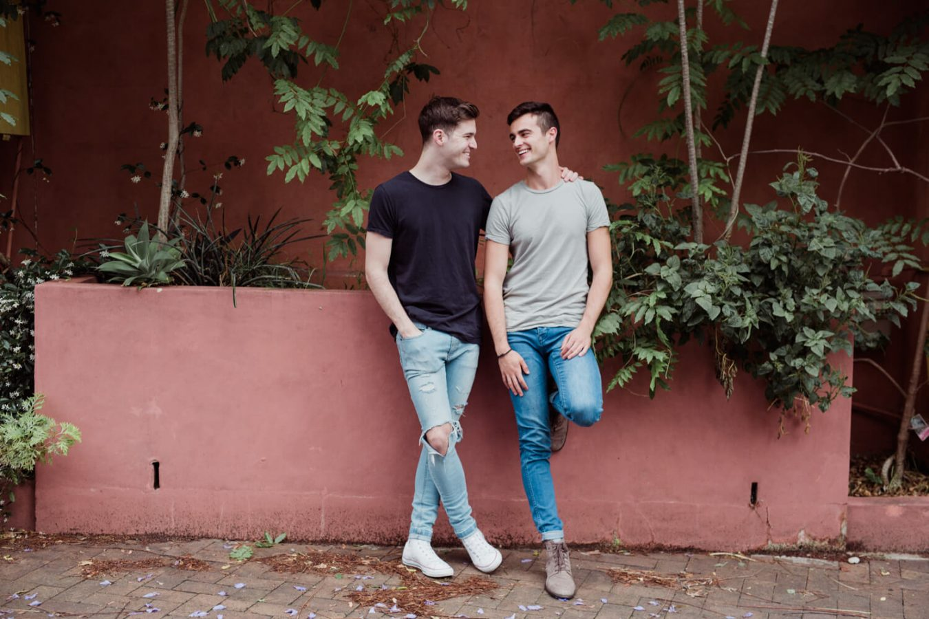 Gay friendly wedding photographer Sydneysame sex couple stand against wall