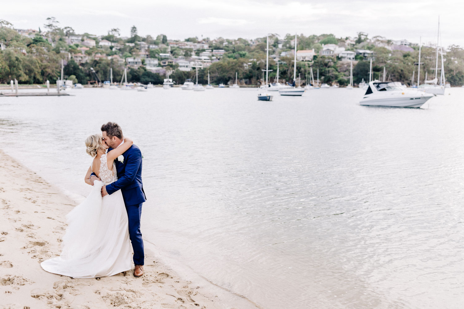 Orso The Spit wedding Jackie and Jared Kat Rollings photography couple kissing on the beach