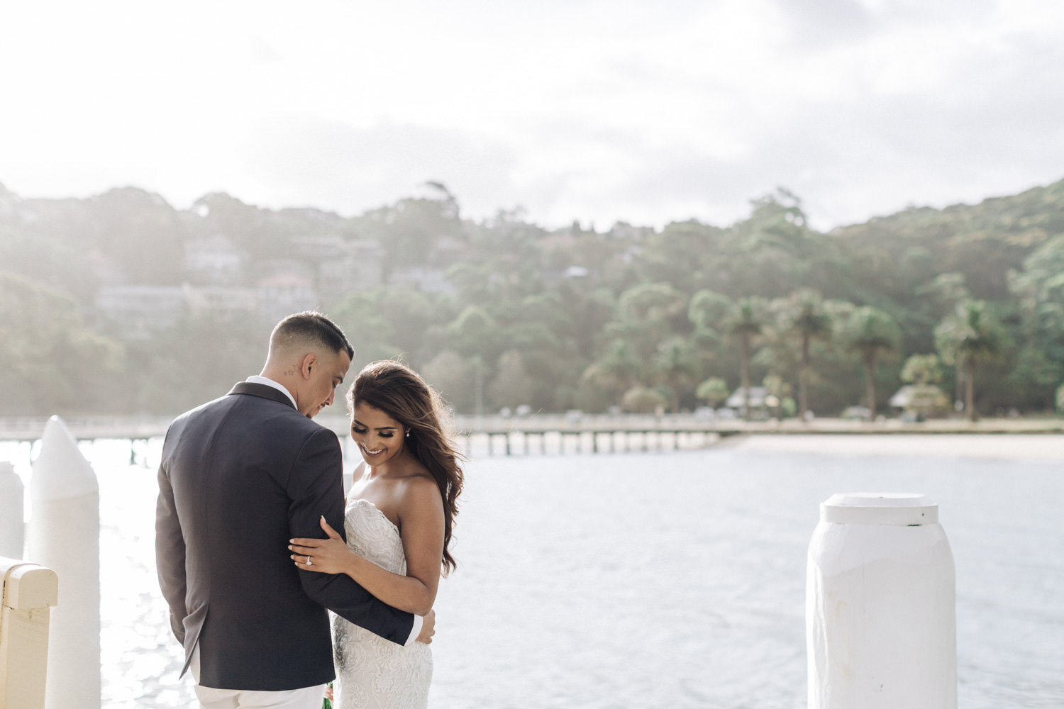 Sergeants Mess Wedding Samirah Keegan Bride and groom stand on wharf in chowder bay