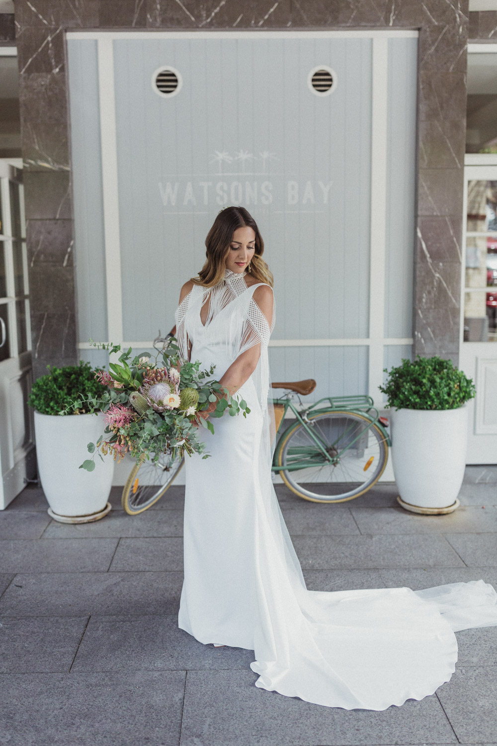 bride standing outside the watsons bay hotel