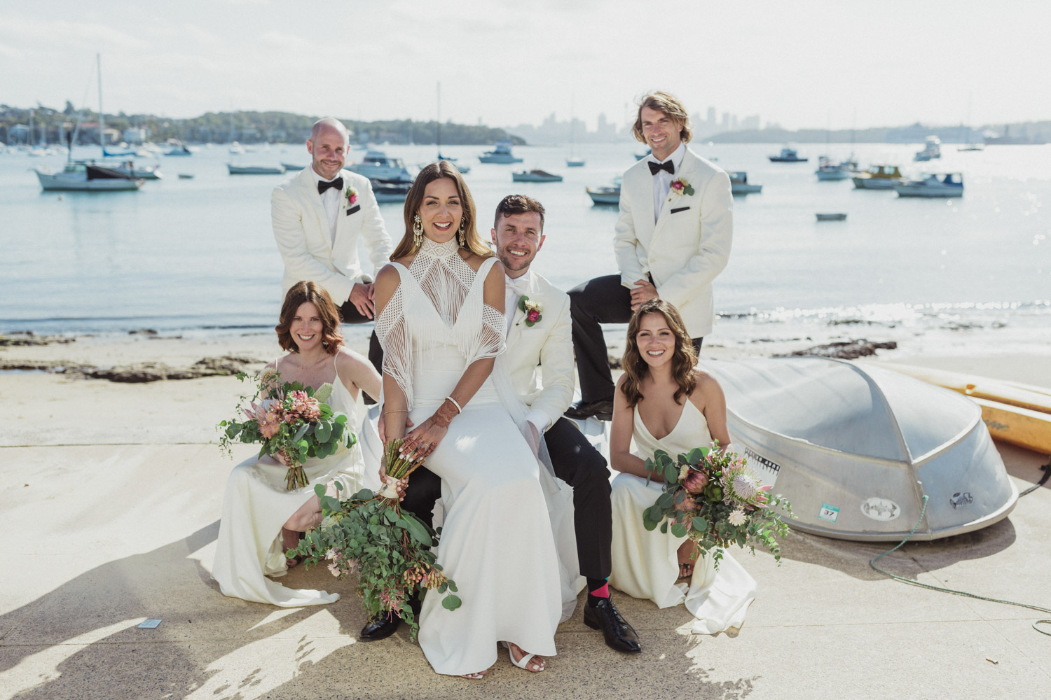 bridal party stand around and sit on boat at Watsons Bay,Sydney