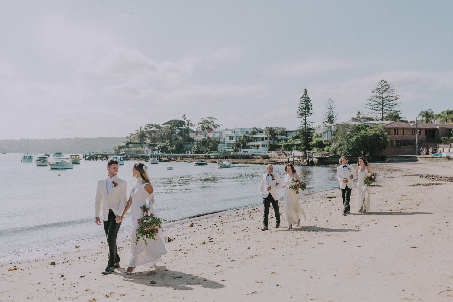bridal party walking on the beach at Watsons Bay,Sydney