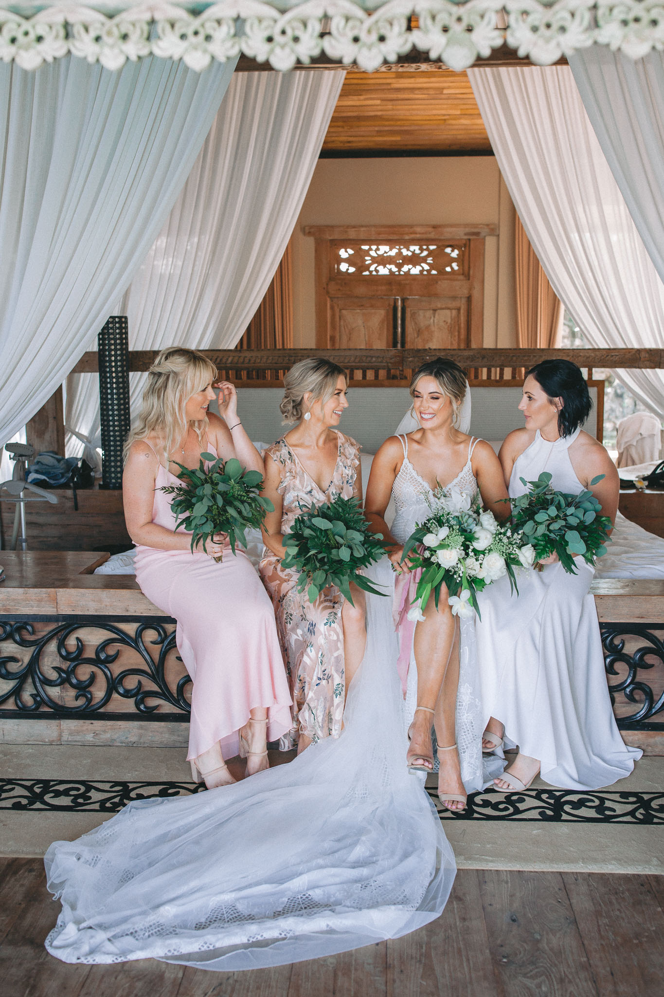 Khayangan Estate Bali Wedding Von Kiel Kat Rollings Photography bride and bridesmaids sitting on the bed