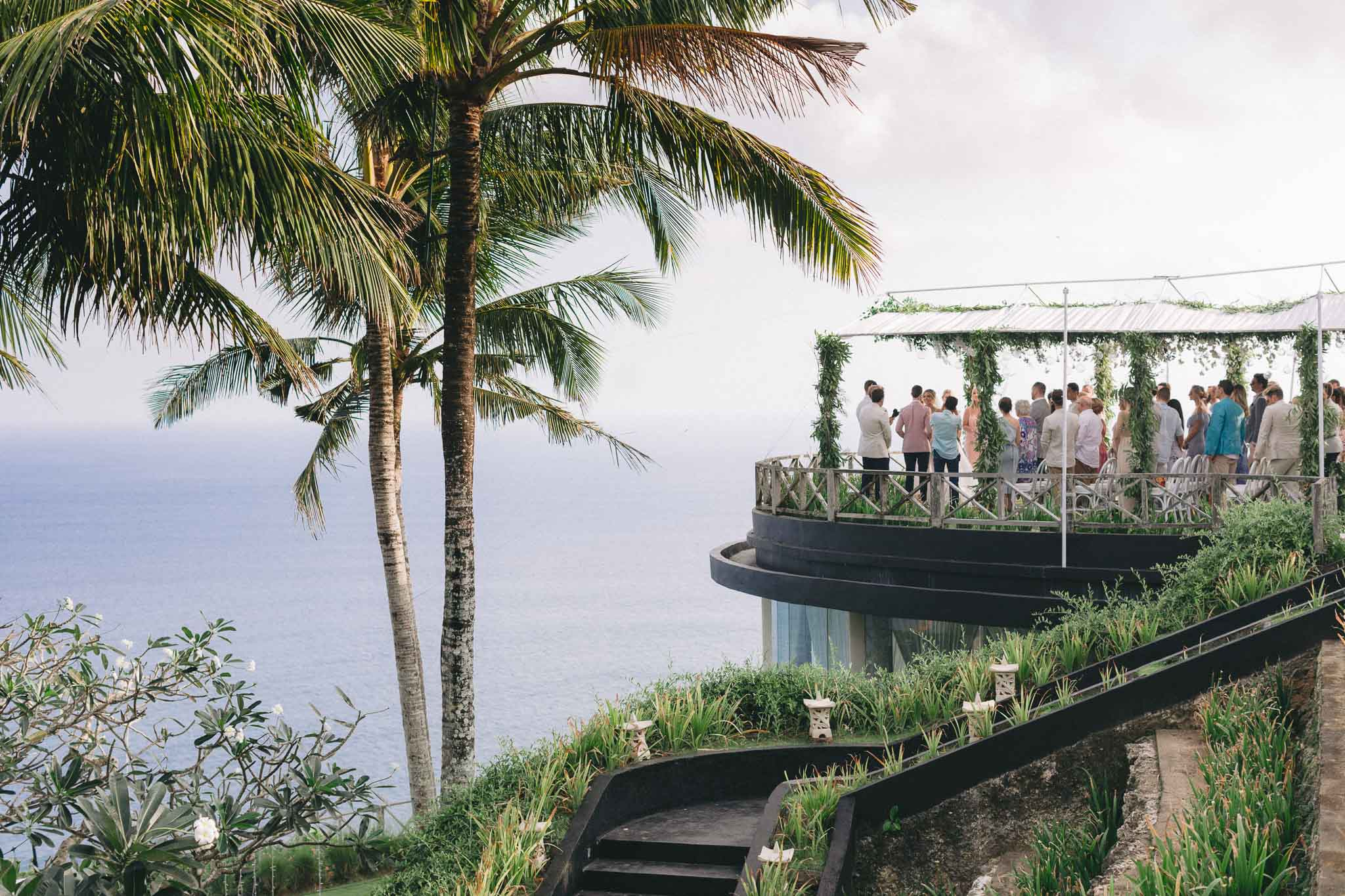 Khayangan Estate Bali Wedding Kat Rollings wide shot of ceremony with guests, bride and groom